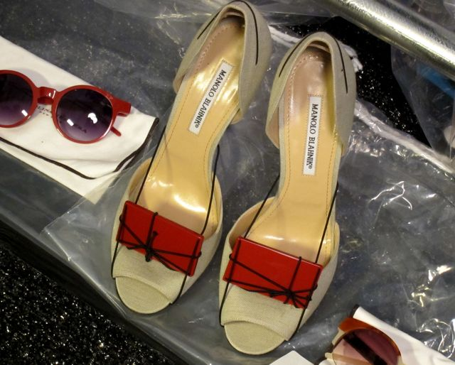 "customized Manolos, complete with Carolina Herrera ""plaques"""